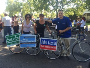 Amy, School Board Member Louise Seeba and Representative John Lesch preparing for the Payne Ave Harvest Parade.